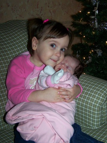 1st Time Maddie held Lila by herself.